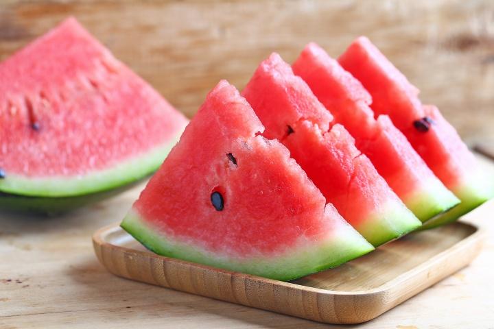 fresh-sliced-watermelon-wooden-background